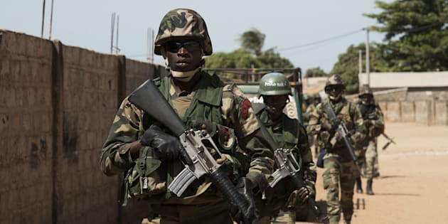 BANJUL, GAMBIA - JANUARY 22: ECOWAS troops patrol in the streets of Barra town after the former President Yahya Jammeh left the country, in Banjul, Gambia on January 22, 2017. Yahya Jammeh left Gambia after agreeing to relinquish power earlier in the day, bring an end to a political crisis that has gripped the country since his election defeat last month. (Photo by Xaume Olleros/Anadolu Agency/Getty Images)