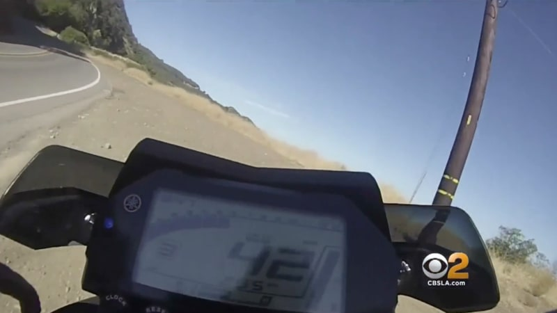 Watch from motorcyclist's POV as he flies off cliff, survives