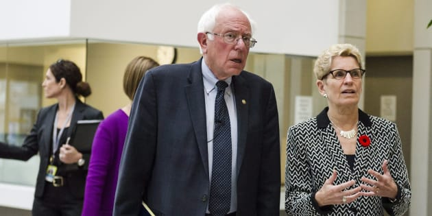 U.S. Sen. Bernie Sanders meets Ontario Premier Kathleen Wynne on a visit to the Women's College Hospital in Toronto on Saturday.