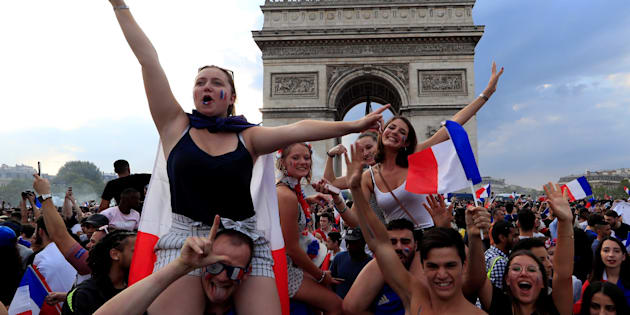 Soccer Football - World Cup - Final - France vs Croatia - Paris, France, July 15, 2018 - France fans celebrate on the Champs-Elysees avenue near the Arc de Triomphe after they defeated Croatia in their Soccer World Cup final match.   REUTERS/Gonzalo Fuentes