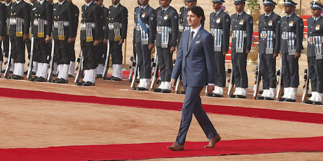 Prime Minister Justin Trudeau inspects a guard of honour during a ceremonial reception at the presidential estate in New Delhi, India, on Feb. 23, 2018.