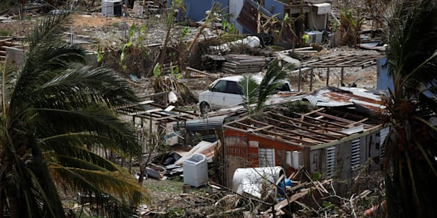 Damaged houses are seen after the area was hit by Hurricane Maria in Canovanas, Puerto Rico September 26, 2017. REUTERS/Carlos Garcia Rawlins