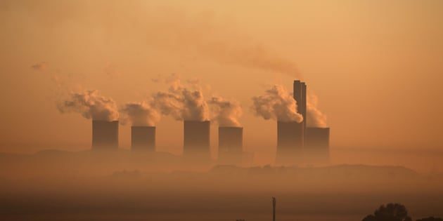 Steam rises at sunrise from the Lethabo Thermal Power Station, an Eskom coal-burning power station  near Sasolburg in the northern Free State province, March 2, 2016. South Africa's energy regulator said on Tuesday it had allowed state-owned power firm Eskom to raise tariffs by 9.4 percent in the 2016/17, less than what had been requested by the cash-strapped utility. REUTERS/Siphiwe Sibeko