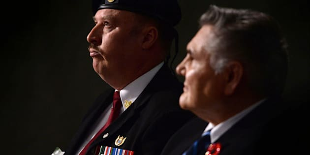 Veterans Joseph Burke, left, and Richard Blackwolf look on at Parliament Hill in Ottawa on June 3, 2014.