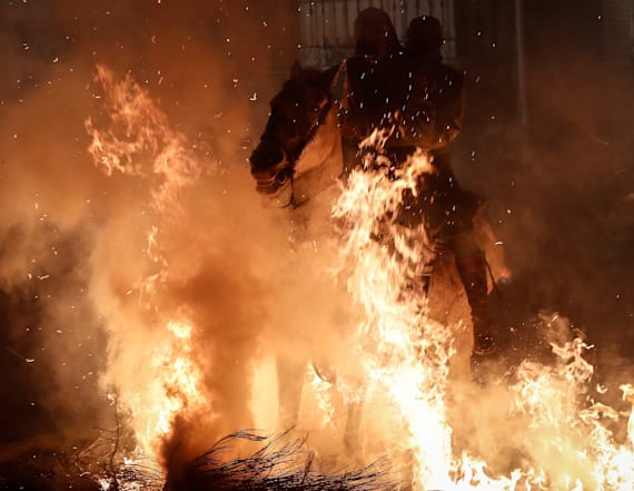 Horses jump through flames at controversial festival