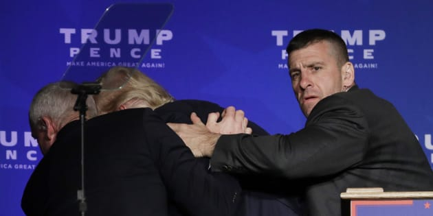 Members of the Secret Service rush Republican presidential candidate Donald Trump off the stage at a campaign rally in Reno, Nev., on Saturday, Nov. 5, 2016. (AP Photo/John Locher)