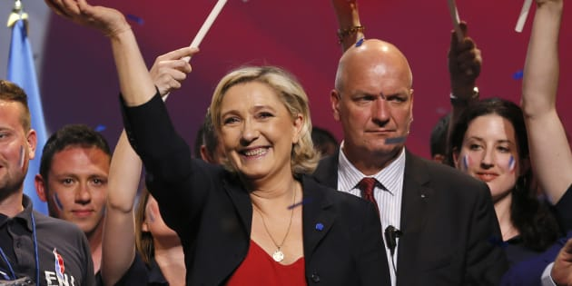Marine Le Pen, French National Front (FN) political party leader and candidate for the French 2017 presidential election, attends a campaign rally as her bodyguard Thierry Legier (R) stands near in Marseille, France, April 19, 2017. REUTERS/Robert Pratta