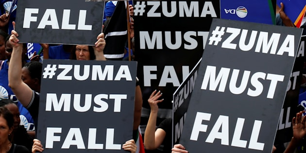 Demonstrators carry banners as they take part in a protest calling for the removal of South Africa's President Jacob Zuma in Johannesburg, South Africa April 7, 2017.