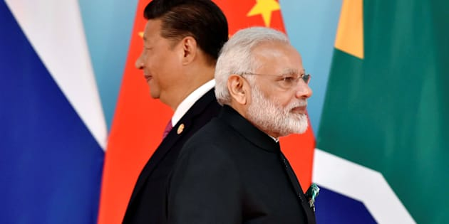Chinese President Xi Jinping (L) and Indian Prime Minister Narendra Modi attend the group photo session during the BRICS Summit at the Xiamen International Conference and Exhibition Center in Xiamen.