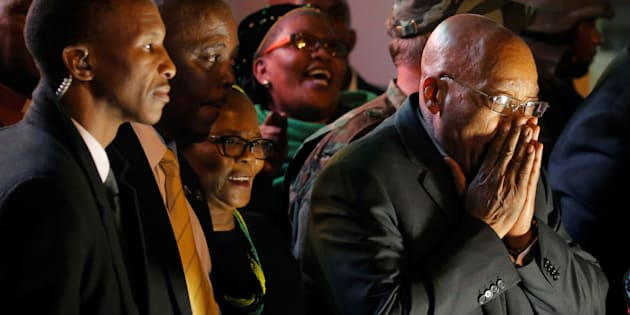 South African President Jacob Zuma reacts during an address for his supporters after he survived a no-confidence motion in parliament in Cape Town, South Africa, August 8, 2017. REUTERS/Mike Hutchings