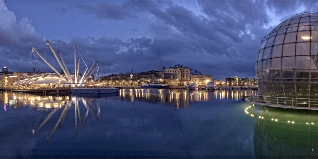 Genoa, Italy, night view on harbor and old city, the area of expo