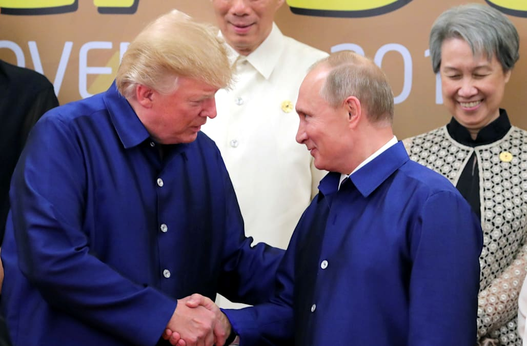 Dressed in silk, Trump and Putin shake hands at APEC summit dinner