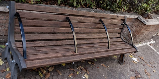 "Some benches with bars, like this one seen in Rome, Italy, are brought up in discussions over ""hostile"" public spaces that aim to deter loitering. Some argue they are also meant to keep homeless people from sleeping on them."