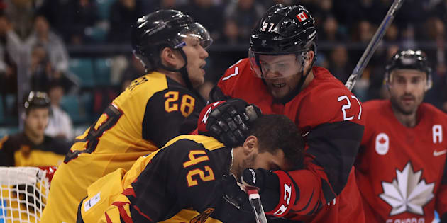 Canada's Cody Goloubef collides with Germany's Yasin Ehliz. Canada lost its semifinal game against Germany and will play for bronze.
