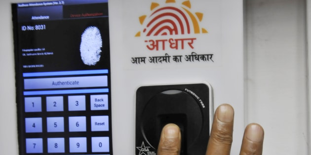 Employee marks  attendance through Aadhaar based System in the Planning Commission.