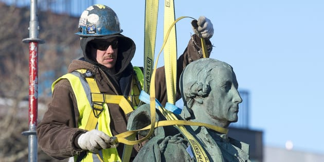 Contractors remove the statue of Edward Cornwallis, a controversial historical figure, in a city park in Halifax on Jan. 31, 2018.