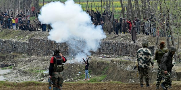 Local protesters trying to disrupt an anti-militant operation at Chadoora area in Budgam district on Tuesday.