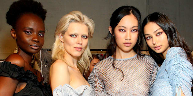 Models backstage ahead of the Alice McCall show at Mercedes-Benz Fashion Week Resort 18 Collections at Carriageworks.