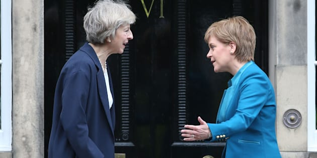 Theresa May (left) is greeted by Scotland's First Minister Nicola Sturgeon at Bute House in Edinburgh.
