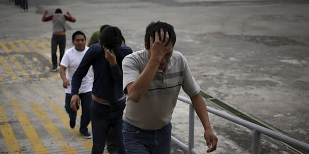 Illegal migrants from Guatemala, deported from the U.S., arrive at an air force base in Guatemala City, March 19, 2015. The flight carrying some 150 illegal migrants arrived on Thursday, according to authorities.    REUTERS/Jorge Dan Lopez