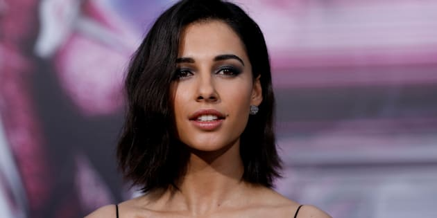 Cast member Naomi Scott poses at the premiere of