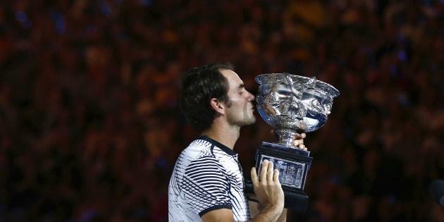 Melbourne Park, Melbourne, Australia - 1/29/17 - Switzerland's Roger Federer celebrates winning his Men's singles final match against Spain's Rafael Nadal. (REUTERS/David Gray)