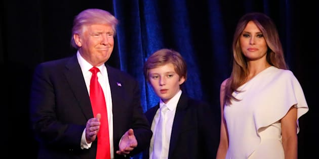 Republican U.S. president-elect Donald Trump stands with his son Barron (C) and wife Melania at his election night rally in Manhattan, New York, U.S., November 9, 2016. REUTERS/Carlo Allegri
