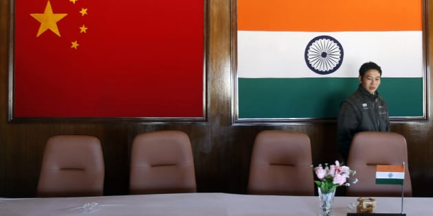 A man walks inside a conference room used for meetings between military commanders of China and India, at the Indian side of the Indo-China border at Bumla, in Arunachal Pradesh, November 11, 2009.