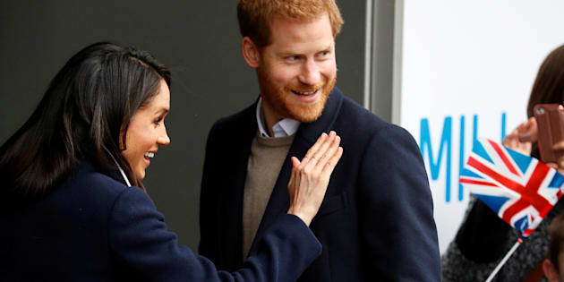 Meghan Markle waves to local school children during a walkabout with Prince Harry during a visit to Birmingham, Britain, March 8, 2018.