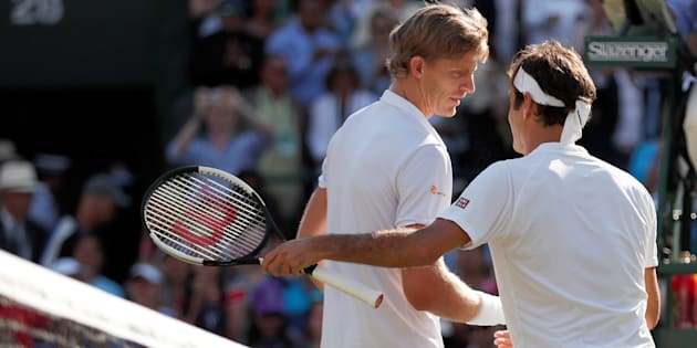 Tennis - Wimbledon - All England Lawn Tennis and Croquet Club, London, Britain - July 11, 2018. South Africa's Kevin Anderson celebrates winning his quarter-final match against Switzerland's Roger Federer.