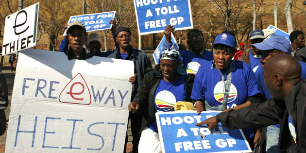 Democratic Alliance (DA) supporters protest against the electronic road  tolling system outside the Constitutional Court in Johannesburg, South Africa on Wednesday, Aug. 15, 2012.