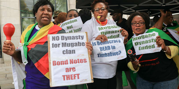 Jubilant protesters celebrate outside Zimbabwe House on 15 November, 2017, in London, England, after news of unrest and a reported military coup against President Robert Mugabe in Harare, Zimbabwe.