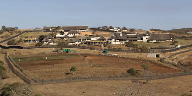 A general view of the Nkandla home (behind the huts) of South Africa's President Jacob Zuma in Nkandla is seen in this file picture taken August 2, 2012. REUTERS/Rogan Ward/Files