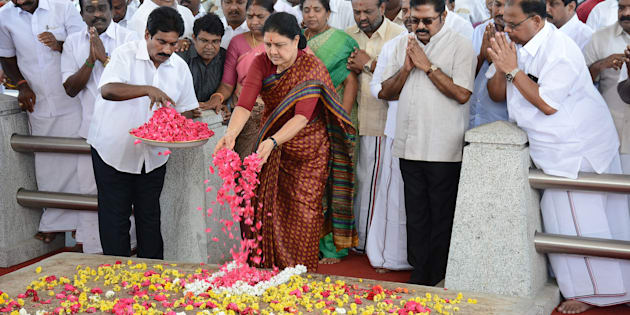 All India Anna Dravida Munnetra Kazhagam (AIADMK) leader VK Sasikala pays her respects at the memorial for former state chief minister Jayalalithaa Jayaram before leaving to surrender to authorities, following a Supreme Court ruling, in Chennai on Febuary 15, 2017.    India's Supreme Court jailed the annointed next leader of Tamil Nadu for four years for corruption on February 14, heightening the turmoil in a state still reeling from the death of its long-time matriarch. VK Sasikala was told to surrender immediately to prison authorities after judges overturned her acquittal in a long-running 'disproportionate assets' case that also involved her late mentor Jayalalithaa Jayaram.