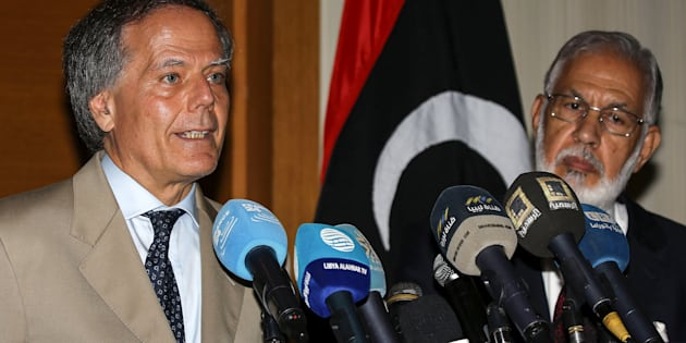 Italian Foreign Minister Enzo Moavero Milanesi (L) speaks during a press conference with his Libyan unity government counterpart Mohamed Taha Siala in the capital Tripoli on July 7, 2018. (Photo by Mahmud TURKIA / AFP)        (Photo credit should read MAHMUD TURKIA/AFP/Getty Images)