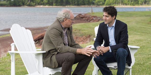 Prime Minister Justin Trudeau chats with Premier Wade MacLauchlan in Cardigan, P.E.I. on  June 29, 2017.