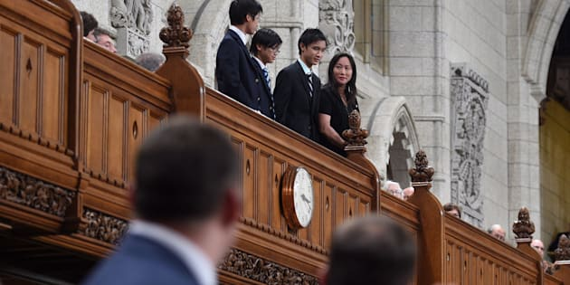 Members of the House of Commons applaud the family of late MP Arnold Chan as they pay tribute in the House of Commons on Parliament Hill in Ottawa on Sept. 18, 2017.