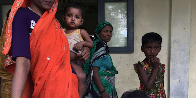 A Hindu family is seen at a shelter near Maungdaw, Rakhine state, Myanmar September 12, 2017. REUTERS/Stringer