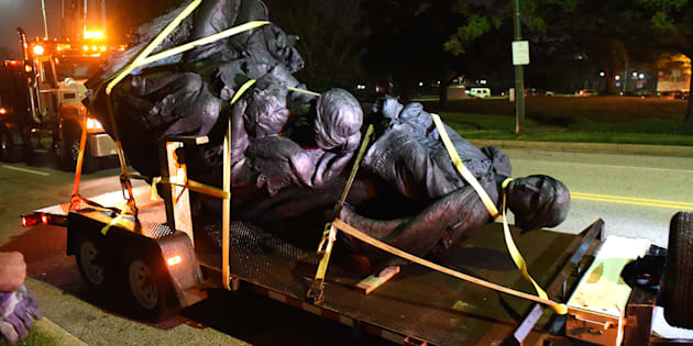 A monument dedicated to the Confederate Women of Maryland lies on a flatbed trailer near the intersection of Charles St. and University Parkway early Wednesday morning, Aug. 16, 2017 after it was taken down. (Jerry Jackson/Baltimore Sun/TNS via Getty Images)