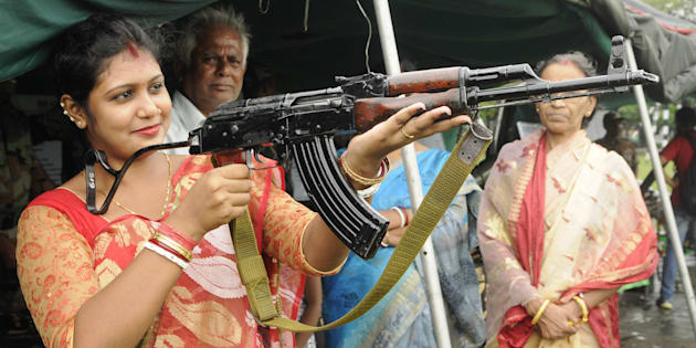 [REPRESENTATIONAL IMAGE] File photo of a housewife trying to hold an AK-47 rifle during an exhibition in Kolkata.