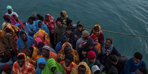 POZZALLO, ITALY - FEBRUARY 19:  Refugees and migrants wait on deck of the Spanish NGO Proactiva Open Arms rescue vessel Golfo Azzurro to disembark after being rescued off Libyan coast north of Sabratha, Libya on February 19, 2017 in Pozzallo, Italy. 466 migrants were rescued in high seas last Friday by the Italian Coast Guard and the Spanish NGO Proactiva Open Arms rescue vessel Golfo Azzurro. Proactiva Open Arms are a Spanish charity based out of Malta who provide search and rescue assistance to refugees and migrants in distress at sea. They patrol the SAR and Rescue Zone off the coast of Libya running rescue missions for the hundreds of migrants who continue to make perilous journey across the Mediterranean in hope of reaching the European mainland.  (Photo by David Ramos/Getty Images)