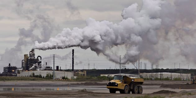 A dump truck works near the Syncrude oil sands extraction facility near the city of Fort McMurray, Alta., June 1, 2014. The National Energy Board says renewable sources of electricity in Canada will grow over the next 20 years but so will Canadian oil and natural gas production.