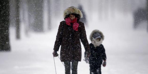 Alyssa Gerber walks through a Toroto park during a snowstorm on Dec. 14, 2013.