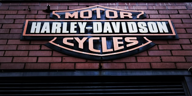 The Harley Davidson logo is displayed on a building at the New York store March 8, 2018 in New York City. The motorcycle maker has lowered its profit expectations due to the ongoing trade war.
