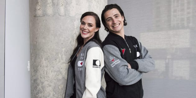 Ice dancing pair Tessa Virtue and Scott Moir pose for a photo at the Entertainment One office in Toronto, Tues. July, 10, 2018.