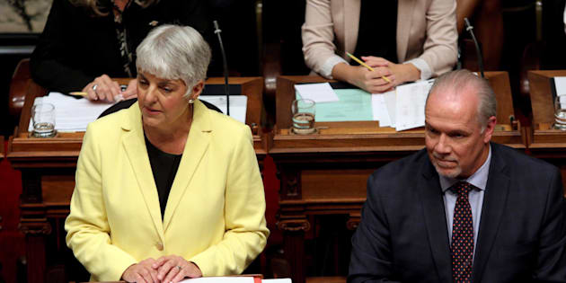 B.C. Finance Minister Carole James delivers the budget as Premier John Horgan looks on from the legislative assembly in Victoria, B.C., on Sept. 11, 2017.