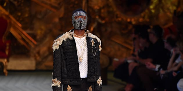 Wizkid walks the runway at the Dolce & Gabbana show during Milan Men's Fashion Week Spring/Summer 2019 on June 16 2018 in Milan, Italy.