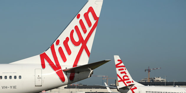 Virgin Australia check-in queues have left passengers waiting at Sydney Airport on Tuesday.