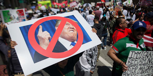 LOS ANGELES, CALIFORNIA - MAY 1:  A woman carries a placard critical of Republican presidential candidate Donald Trump during one of several May Day marches on May 1, 2016 in Los Angeles, California. Immigrants, union members, workers and supporters are participating in the annual marches in downtown Los Angeles to call for greater rights for immigrants and improved conditions for workers.  (Photo by David McNew/Getty Images)