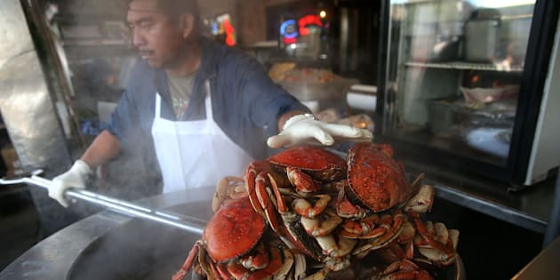 A cook at Nick's Lighthouse prepares Dungeness crab on November 5, 2015 in San Francisco, California. The California Fish and Game Commission suspended recreational Dungeness crab fishing for 180 days in 2015 due to high levels ofdomoic acid, a neurotoxin.